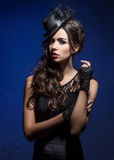 Fashion portrait of a brunette woman in black clothes Royalty Free Stock Image