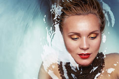 Fashion portrait of charming glamourous woman in water Royalty Free Stock Photo