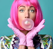 Fashion portrait of cheerful woman inflating the bubble gumin ho Stock Photo