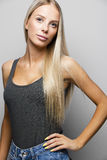 Fashion portrait of a confident and blonde young woman Stock Image