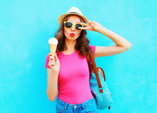 Fashion portrait cool young woman with ice cream over colorful blue. Background royalty free stock images