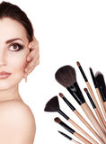 Fashion portrait with cosmetic brushes Royalty Free Stock Photos