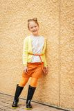 Fashion portrait of a cute little girl of 7 years old royalty free stock photography