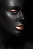 Fashion portrait of a dark-skinned girl with color Royalty Free Stock Photo