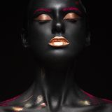 Fashion portrait of a dark-skinned girl with color make-up. Beauty face. Royalty Free Stock Image