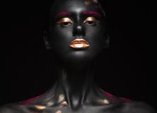 Fashion portrait of a dark-skinned girl with color make-up. Beauty face. stock photo