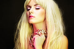 Fashion portrait of elegant blonde woman with magnificent hair Royalty Free Stock Photo