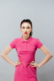 Fashion portrait of elegant Girl in pink dress Royalty Free Stock Photography
