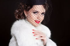 Fashion Portrait of elegant retro woman wearing little hat with Stock Image