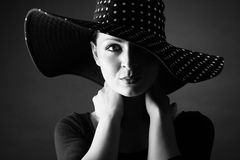 Fashion portrait of elegant woman in black and white hat stock photo