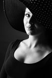 Fashion portrait of elegant woman in black and white hat stock photos