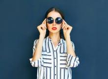 Fashion portrait of elegant woman lady in a black sunglasses Stock Image