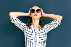 Fashion portrait elegant woman lady wearing a black sunglasses. Posing over a gray background Royalty Free Stock Image