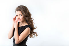 Fashion portrait of elegant woman with magnificent hair. Brunette girl. Royalty Free Stock Image