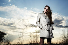 Fashion portrait of elegant woman in a raincoat Stock Photo