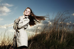 Fashion portrait of elegant woman in a raincoat Stock Images