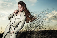 Fashion portrait of elegant woman in a raincoat Stock Image