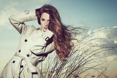 Fashion portrait of elegant woman in a raincoat Stock Photography