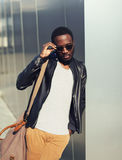 Fashion portrait of elegant young african man wearing sunglasses Stock Photo