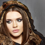 Fashion portrait. Fur, leather. Young woman Royalty Free Stock Photography
