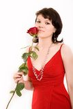 Fashion portrait of a girl. The Red rose in hands at the girl royalty free stock photography