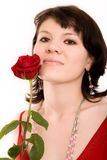 Fashion portrait of a girl. The girl in a red dress with a rose stock images