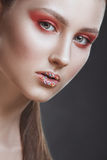 Fashion-portrait of the girl with a fantasy make-up. stock images