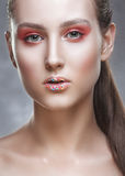 Fashion-portrait of the girl with a fantasy make-up. royalty free stock photography