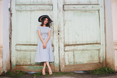 Fashion portrait of a girl. Fashion portrait of a happy girl. vintage dress and hat royalty free stock images