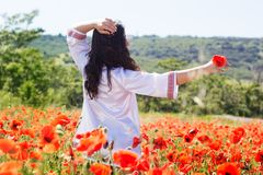 Fashion portrait of girl near red roses Royalty Free Stock Photography
