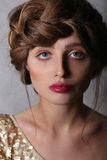 Fashion portrait girl's face with a red lips and brown hair. royalty free stock photo