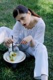 Fashion portrait of a girl who eats strange food Stock Images