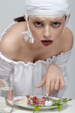 Fashion portrait of a girl who has food from medicines instead o Royalty Free Stock Photos