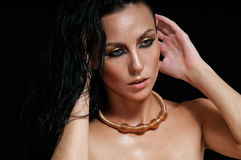Fashion portrait of glamourous woman with wet hair on black back Royalty Free Stock Photography