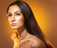 Fashion portrait with golden makeup. Royalty Free Stock Photos