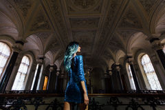 Fashion portrait of gorgeous girl with blue dyed hair long. The beautiful evening cocktail dress. Royalty Free Stock Photography