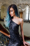 Fashion portrait of gorgeous girl with blue dyed hair long. The beautiful evening cocktail dress. Stock Photography