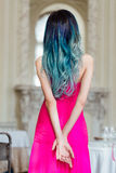 Fashion portrait of gorgeous girl with blue dyed hair long. The beautiful evening cocktail dress. stock photos