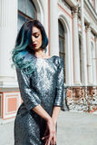 Fashion portrait of gorgeous girl with blue dyed hair long. The beautiful evening cocktail dress. Stock Image