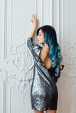 Fashion portrait of gorgeous girl with blue dyed hair long. The beautiful evening cocktail dress. Royalty Free Stock Photo