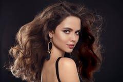 Fashion portrait of gorgeous sexy brunette woman with long healt Stock Photos