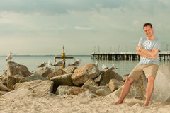 Fashion portrait of handsome man on the beach Stock Image