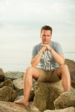 Fashion portrait of handsome man on the beach Royalty Free Stock Photography