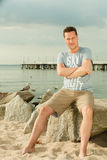 Fashion portrait of handsome man on the beach Royalty Free Stock Photos