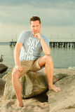 Fashion portrait of handsome man on the beach Stock Images