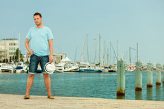 Fashion portrait of handsome man on pier against yachts Royalty Free Stock Photo