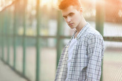 Fashion portrait handsome man in summer Stock Photos