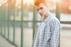 Fashion portrait handsome man in summer Stock Photos