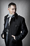 Fashion portrait of handsome young man. Model in black coat for autumn and spring Stock Photo