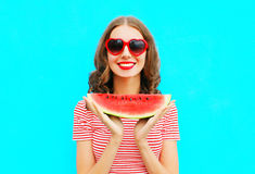 Fashion portrait happy smiling young woman holding slice of watermelon Stock Photography